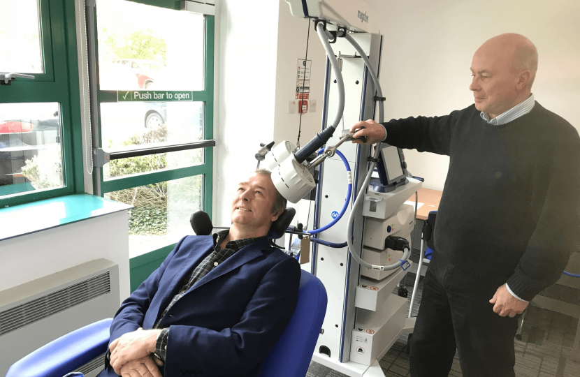 Simon Hart MP is given a demonstration of a TMS therapy chair