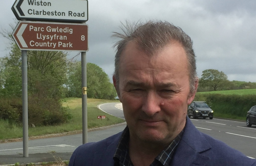 Simon Hart MP pictured at the Llys Y Fran Country Park sign on the A40 near Slebech.  The attraction has been closed since last year and will remain closed for some time to come.